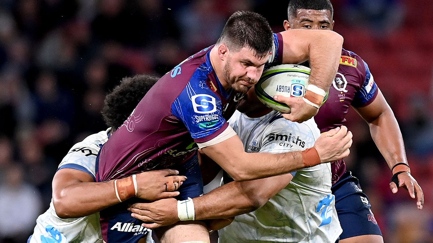 Liam Wright of the Reds takes on the defence during the round four Super Rugby Trans-Tasman match between the Queensland Reds and the Blues at Suncorp Stadium on June 04, 2021 in Brisbane, Australia. (Photo by Bradley Kanaris/Getty Images)