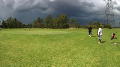 Golfers keep playing at Werrington as storm clouds roll in. (Zoya Liu)