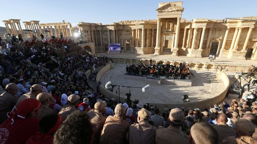 The Russian Mariinsky Theater Orchestra, conducted by Valery Gergiev performs during a concert in the Palmyra amphitheater in Palmyra on May 5, 2016. (AAP)