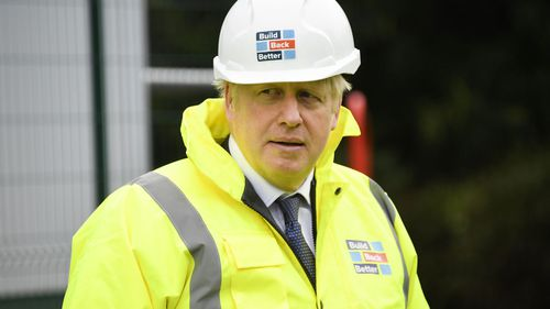 British Prime Minister Boris Johnson visits the Conway Heathrow Asphalt & Recycling Plant construction site in west London on October 3, 2020 in London, England