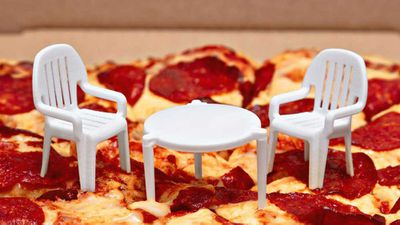 Pizza restaurant put tiny chairs around table