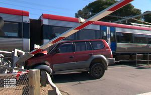 Heroic bystanders save Adelaide driver from under train after crashing into moving carriage