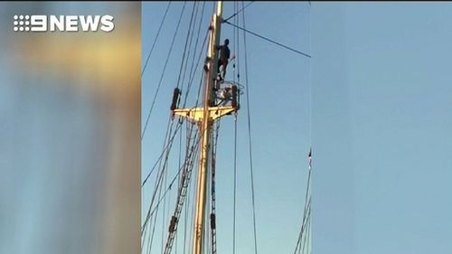 The man climbed to the top of the yacht's mast. (9NEWS)