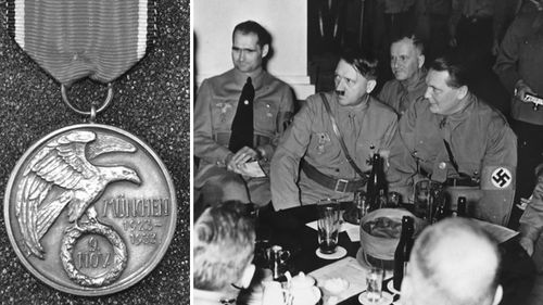 The silver medal which bears the Nazi eagle on one side and an image of the Munich monument, sold for a 'world record' price in an auction.