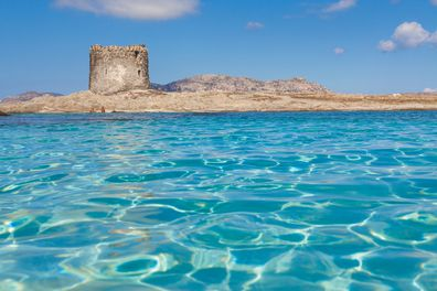 Clear water and La Pelosa Tower in the province of Sassari, Italy.