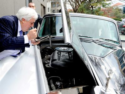 Clive Palmer inspects his Rolls Royce Phantom in Canberra, May 28, 2014. (AAP)