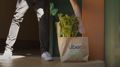 The order is packed at a Woolworths Metro store and then delivered by an Uber Eats driver or rider.