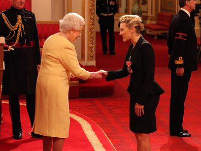 Actress Kate Winslet is awarded a CBE, for services to drama by Queen Elizabeth II during an Investiture ceremony at Buckingham Palace in central London. Date taken: 21-Nov-2012