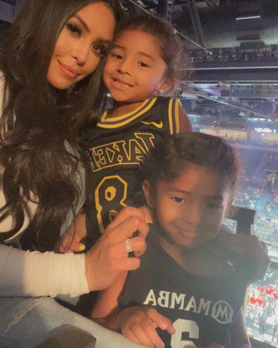 Vanessa Bryant with daughters Bianka and Capri at WNBA game in Las Vegas.