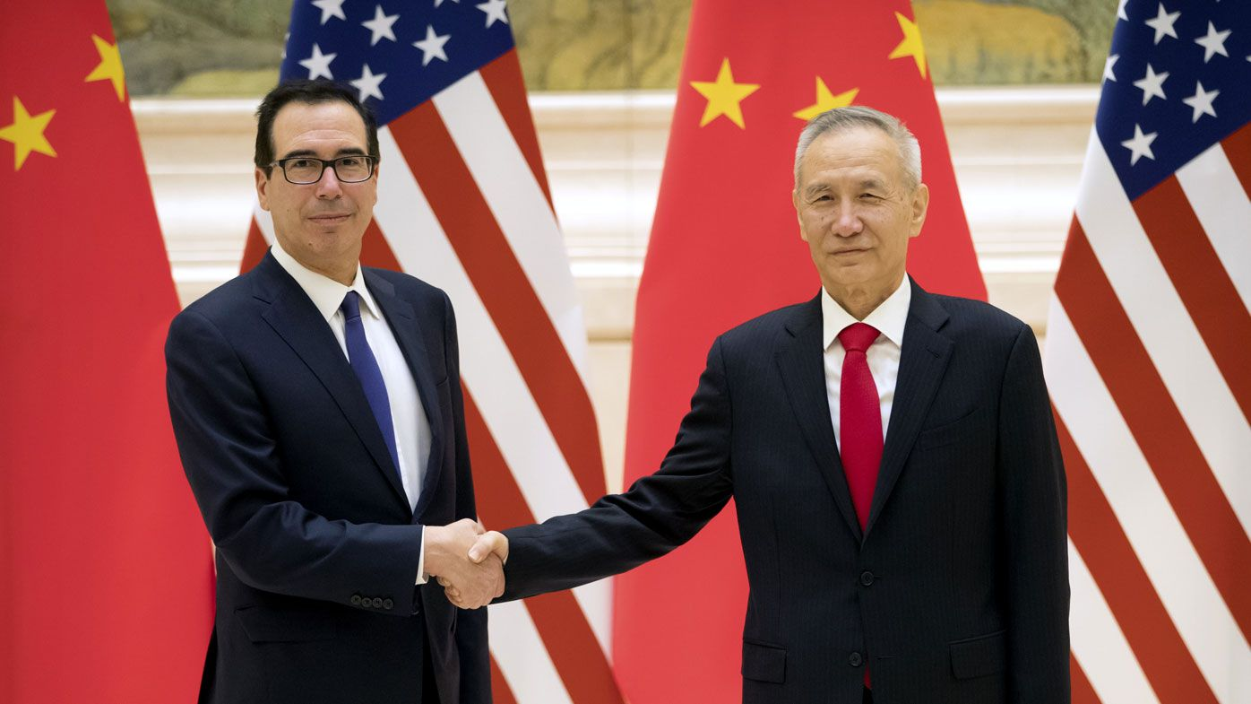 Chinese Vice Premier and lead trade negotiator Liu He (R) and United States Secretary of the Treasury Steven Mnuchin (L) pose for a photo before the opening session of trade negotiations at the Diaoyutai State Guesthouse in Beijing, China.