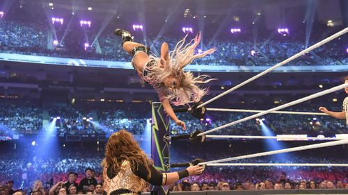 Alexa Bliss flying high before crashing into Nia Jax at Wrestlemania. Picture: Supplied