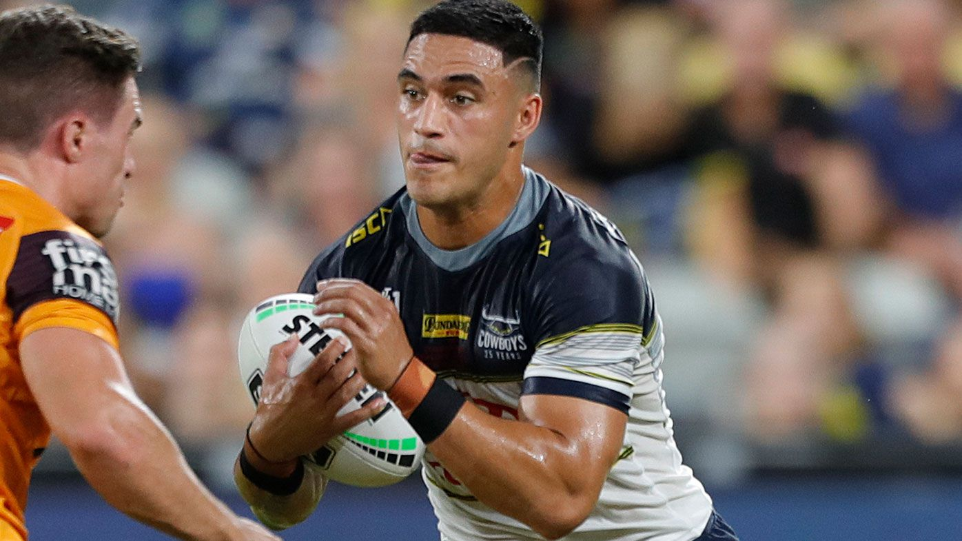 Valentine Holmes runs out for the first time officially for the Cowboys in the NRL. (AAP)