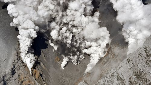 An aerial photo taken from Yomiuri Shimbun's helicopter shows the volcano of Mt. Ontake, spewing gray smoke up into the sky in between Gifu and Nagano Prefecture, central Japan. (AAP)