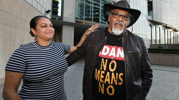 Murrawah Johnson (left) and Adrian Burragubba (right) from the Wangan and Jagalingou traditional owners group are seen outside the Federal Court in Brisbane.