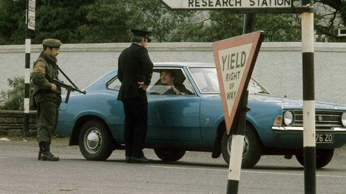 Police and military at a border checkpoint in Ireland in 1974.