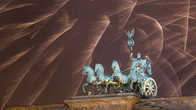 Fireworks light up the night sky during new year celebrations at the Brandenburger Tor in Berlin, Germany
