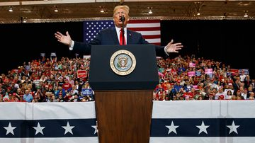 US President Donald Trump speaks during a rally at the IX Centre, in Cleveland.