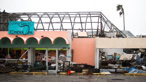 Strong winds have caused significant structural damage to buildings. (AP)