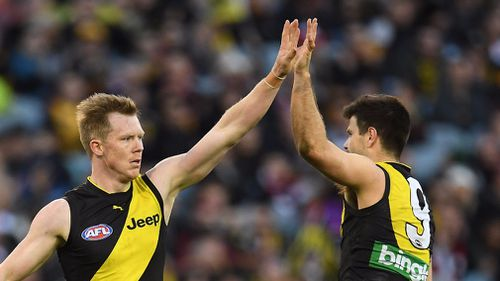 Tigers players Jack Riewoldt (left) and Trent Cotchin react during the Round 23 AFL match between the Richmond Tigers and the St Kilda Saints at the MCG.