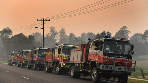 Rural Fire Service tankers at Moruya near Batemans Bay, in NSW, on Saturday. The region is bracing for temperatures in the high 40s.