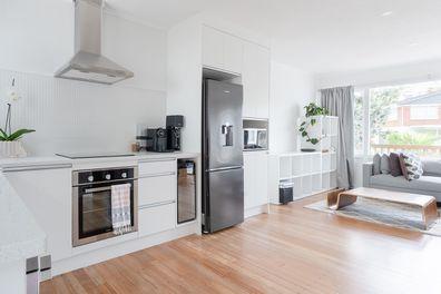 Kitchen with stainless steel fridge