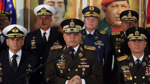 Venezuela's Defense Minister Vladimir Padrino Lopez, centre, has pledged the armed forces' support for President Maduro.