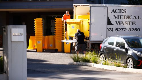 Medical waste bins are delivered to Arcare aged care facility in Maidstone, where a worker has tested positive to COVID-19.