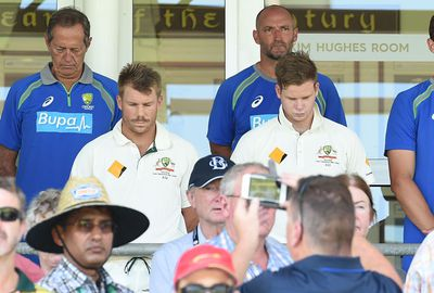 Dave Warner and Steve Smith respect a moments silence before start of play at the WACA.