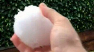 Hail, floods as wintery blast hits Sydney