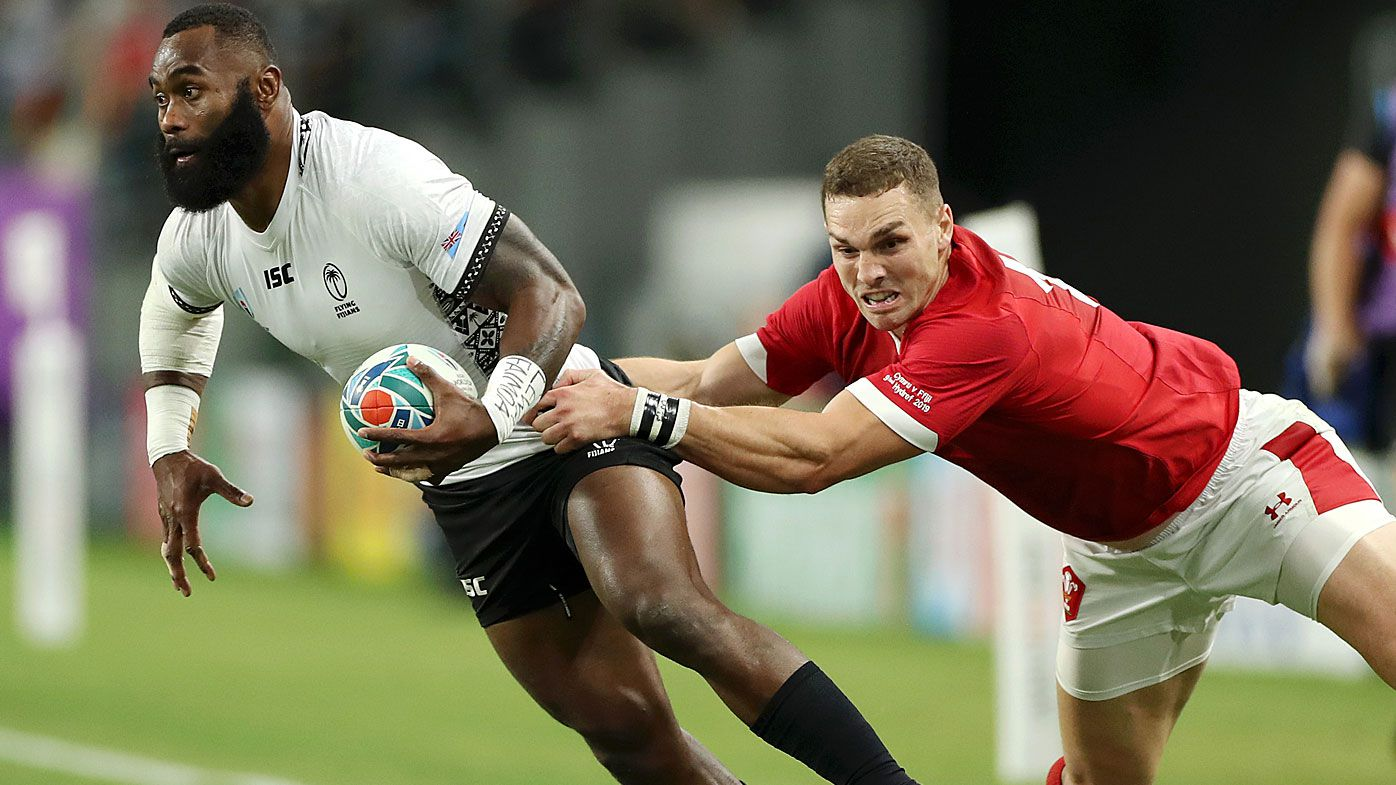 Semi Radradra of Fiji is tackled by George North of Wales
