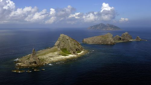 TOKYO, Japan - File photo taken from a Kyodo News airplane shows (from front) Minamikojima, Kitakojima and Uotsuri islands, part of the five main islands in the Senkaku group in the East China Sea, on Sept. 11, 2013, a year after the Japanese government purchased the three islands, which are also claimed by China and Taiwan. (Photo by Kyodo News Stills via Getty Images)