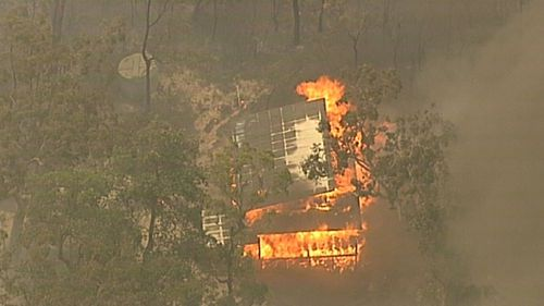 The fire near the Hawkesbury River has damaged property.