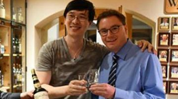 Chinese author Zhang Wei and Sandro Bernasconi, manager of the Waldhaus Am See hotel. (Photo: Facebook).