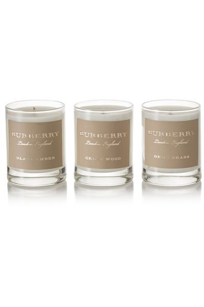 "<em><a href=""https://www.net-a-porter.com/au/en/product/856034/burberry_beauty/cedar-wood--black-amber-and-dewy-grass-set-of-three-scented-candles--3-x-65g"" target=""_blank"" draggable=""false"">Burberry Beauty Cedar Wood, Black Amber and Dewy Grass set of three scented candles, 3 x 65g $99.18</a></em>"