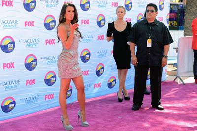 If there's a competition for red carpet poses, Lea Michele wins. Hands down.