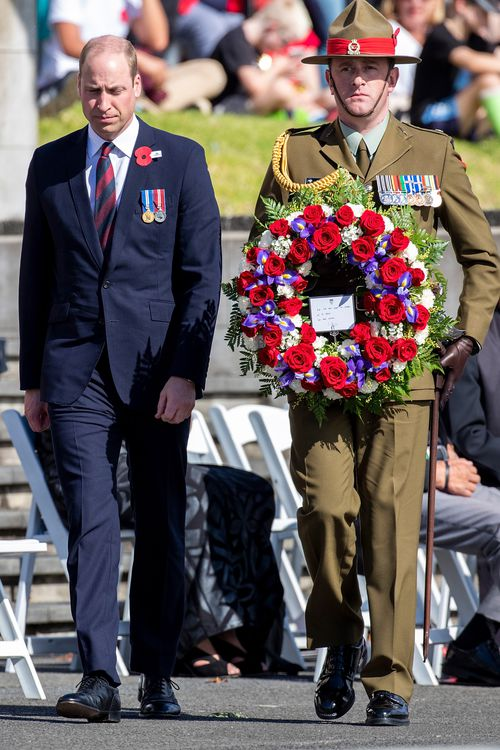 Britain's Prince William, Duke of Cambridge, prepares to lay a wreath during an Anzac Day service at the Auckland War Memorial, in Auckland.