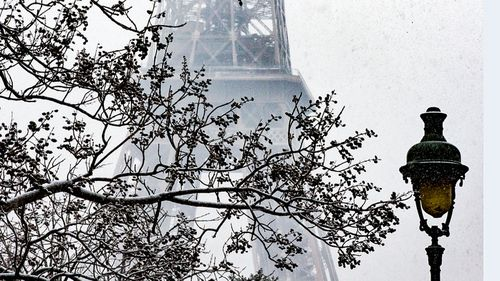 The Eiffel Tower covered in snow. (Photo: AP).