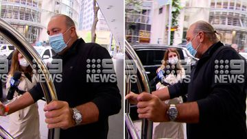 Hillsong founder Brian Houston has returned to Australia to face a charge of concealing sex abuse.