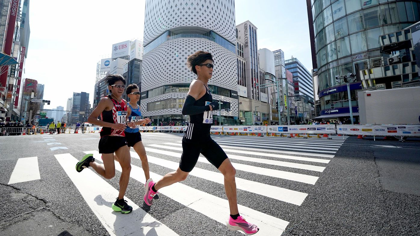 Toshiki Sadakata #156 of Japan leads the chase group during the Tokyo Marathon