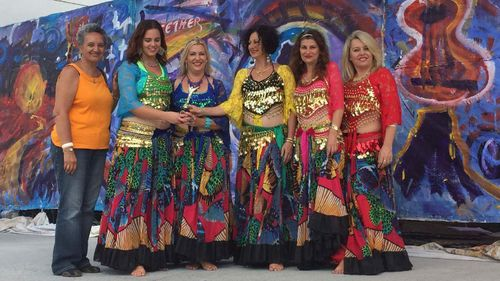 Mrs Orlando (far right) is also part of a belly dancing troupe.