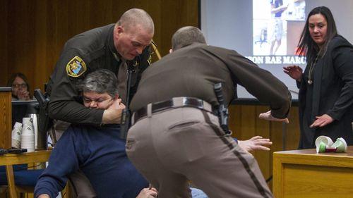 Eaton County Sheriff's deputies restrain Randall Margraves. (AAP)