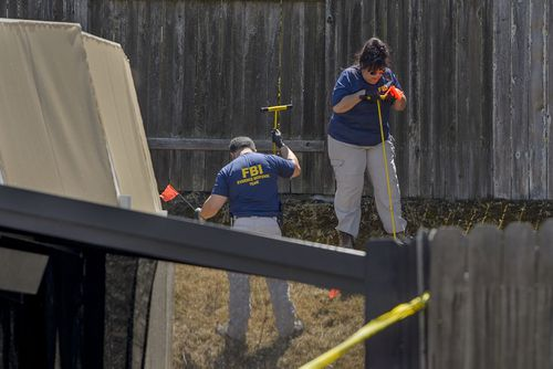 Police conducting a search of DeAngelo's Sacramento home in April. Picture: AP