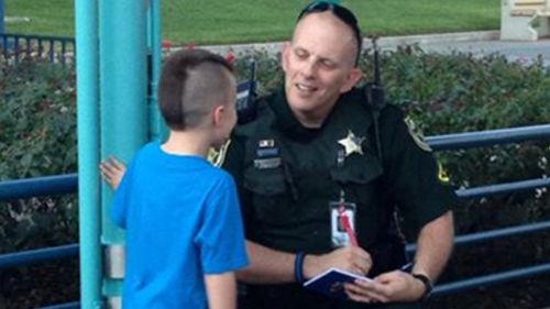 Forget Mickey Mouse -  this kid wants a police officer's autograph