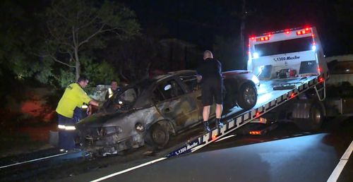 The burnt out car was towed away from scene after being extinguished by the fire crews.