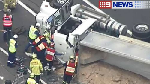 Sydney's M7 closed southbound after truck rollover near Hinchinbrook