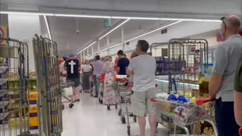 Scenes of panic buying have returned to supermarkets across Brisbane.