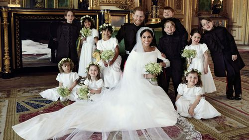 This photograph includes the couple and their bridesmaids and page boys. (Alexi Lubomirski)