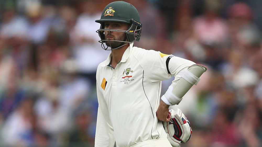 Nathan Lyon watches on, waiting for a decision on a DRS review. (Getty)