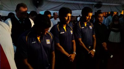 Sri Lanka and England Cricketers observe a  minute silence at an event in Sri Lanka. (BBC reporter Azzam Ameen)