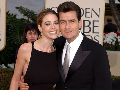 Denise Richards and Charlie Sheen arrive for the Golden Globe Awards at the Beverly Hilton Hotel in Beverly Hills, California January 20, 2002.